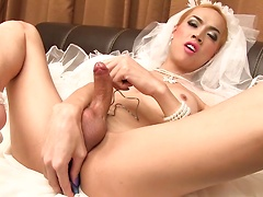 Jacky's gone blonde for her wedding day! Well it's not really her special day but she would make an amazing big cock bride. Jacky is vocal at the beginning then takes off her panties and lets her erect stick and open ass do tell the rest. A vibrating butt