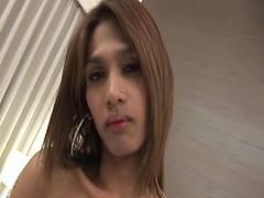 Yoyo is a very sexy ladyboy with long sexy legs, big breasts and a nice shemale cock, watch this ladyboy beauty get naked and play with her tits and cock.
