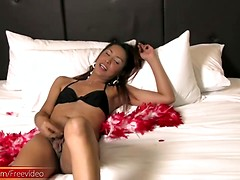 Big butt ladyboy in black bikini jerks off until cumshot