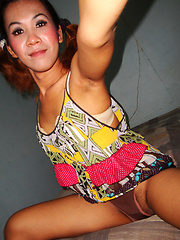 Ladyboy Nam upskirt cock peeks and cute pigtails - Asian ladyboys porn at Thai LB Sex