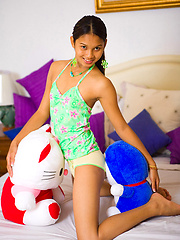 Teenage Ladyboy with small tits plays with stuffed animals