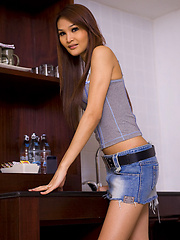 Ladyboy Paris shows her thong bulge in short denim skirt