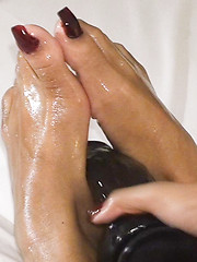 Slick and shiny Ladyboy feet caress a thick black dildo - Asian ladyboys porn at Thai LB Sex