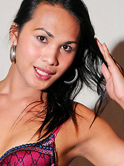 Cute dark-haired ladyboy with killer smile
