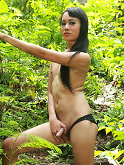 Young Ladyboy going for a walk in the forest and flashing her hard meat - Asian ladyboys porn at Thai LB Sex