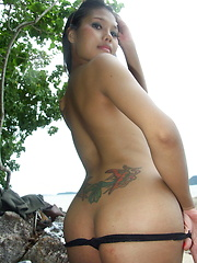 Hot Thai ladyboy proudly flashing her big boobs, her butthole and her dick outdoors - Asian ladyboys porn at Thai LB Sex