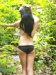 Long haired shemale walking and wanking her dick in a tropical forest - Asian ladyboys porn at Thai LB Sex
