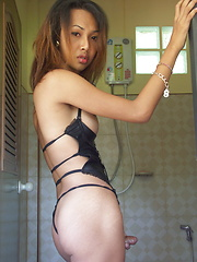 Pik is a busty Thai ladyboy who likes to play with her dick before taking a shower - Asian ladyboys porn at Thai LB Sex