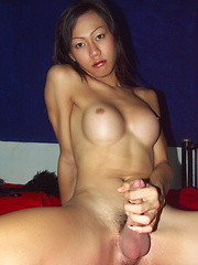 Busty shemale Nancy plays with her boner until shooting a huge load of cum - Asian ladyboys porn at Thai LB Sex