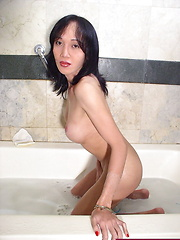 Busty she-male playing with her body while taking a foam bath - Asian ladyboys porn at Thai LB Sex