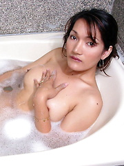 Busty trannie wanking her hard rock boner while taking a foam bath - Asian ladyboys porn at Thai LB Sex