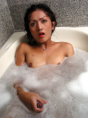 Petite shemale playing with her boner while taking a foam bath - Asian ladyboys porn at Thai LB Sex