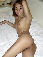 Slim ladyboy stripping on his bed for our voyeuristic pleasure - Asian ladyboys porn at Thai LB Sex