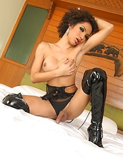 Ladyboy Odette wearing black leather boots - Asian ladyboys porn at Thai LB Sex