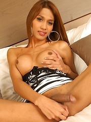 Asian ladyboy Yoyo show off her big titties - Asian ladyboys porn at Thai LB Sex